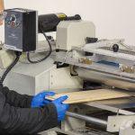 Technician using UV curing system